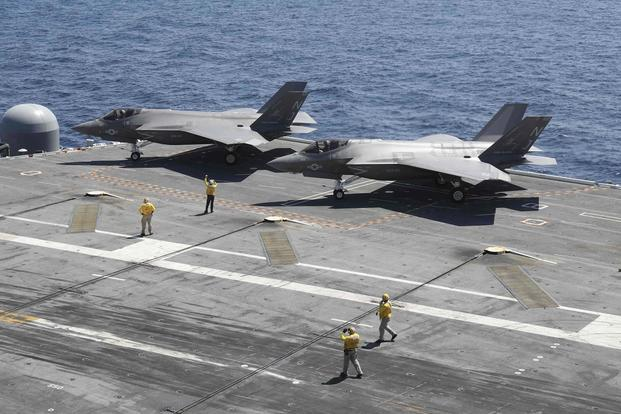 Two F-35C Lightning II aircraft assigned to the Grim Reapers of Strike Fighter Squadron (VFA) 101 sit on the flight deck of the Nimitz-class aircraft carrier USS Abraham Lincoln (CVN 72) on Sept. 4, 2017. The secretary of the Navy says the service has wasted enough money in continuing resolutions to have paid for an entire squadron of the aircraft. Mass Communication Specialist 3rd Class Matt Herbst/Navy