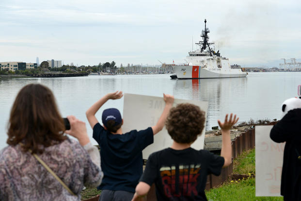 Family and friends gathered on Coast Guard Island in Alameda, Calif., to welcome home their loved ones deployed aboard the Coast Guard Cutter Stratton as the cutter returns home following a 60-day deployment, April 5, 2018. (U.S. Coast Guard photo/Matthew S. Masaschi)