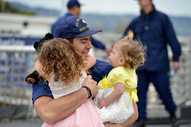 Families reunited aboard the Coast Guard Cutter Stratton after the cutter returned home following a 60-day deployment, April 5, 2018. (U.S. Coast Guard photo/Matthew S. Masaschi)