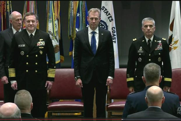 Army Lt. Gen. Paul M. Nakasone takes command of U.S. Cyber Command and the National Security Agency from outgoing chief Navy Adm. Michael S. Rogers during a change-of-command ceremony at Fort Meade, Md., May 4, 2018, (Screen grab from DoD webcast)