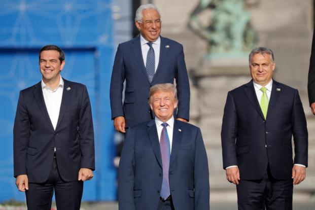President Donald Trump center with from left Greek Prime Minister Alexis Tsipras Portuguese Prime Minister Antonio Costa and Hungarian Prime Minister Viktor Orban pose during a group