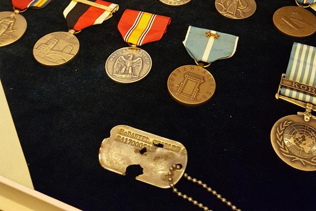 Missing Korean War soldier's sons receive their father's dog tag