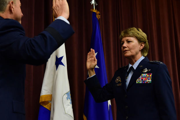 Gen. Maryanne Miller incoming Air Mobility Command commander receives the oath of office from Air Force Chief of Staff Gen. David L. Goldfein during a promotion ceremony at Scott Air Force Base Illinois Sept. 7 2018. (U.S. Air Force
