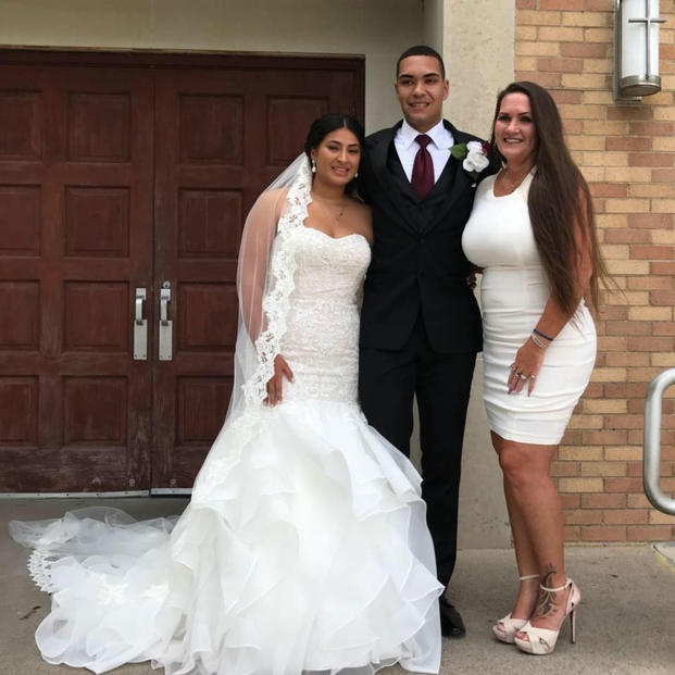 Cpl. Jordan Taylor, Jilia Arroyo and Theresa Johnson on Taylor and Arroyo's wedding day. (Photo courtesy of Theresa Johnson).