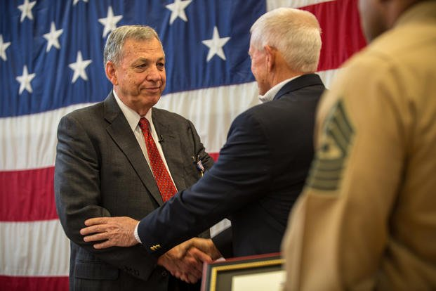 Retired Maj. Gen. John Admire (right) handshakes retired Maj. Edward F. Wright (left) at Portland, Ore., Feb. 1, 2019. Wright was awarded the medal for his actions on Aug. 21, 1967. (Andy O. Martinez/U.S. Marine Corps)
