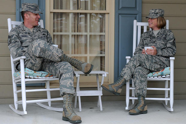 A dual Air Force couple relaxes on their porch at Seymour Johnson Air Force Base, North Carolina. (Photo: U.S. Air Force/Airman 1st Class Aaron J. Jenne.)