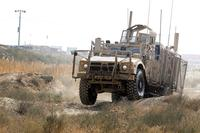 An Oshkosh Defense mine-resistant, ambush-protected vehicle All-Terrain Vehicle (MAT-V) bumps across ruts in the off-road portion of the master driver training course at Bagram Airfield, Afghanistan on Nov. 8, 2017. Spc. Elizabeth White/Army