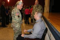 FILE -- Command Sgt. Maj. Staci Rea thanks then Cpl. Matthew Bradford following the telling of his personal story of overcoming amputations and blindness, Sept. 29, 2016. Bradford will be one of three service members invited to attend the 2018 State of the Union Address. (Laura Boyd/U.S. Army )