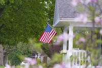 American flag on a house porch