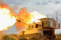 An M109 Paladin gun crew with B Battery, 4th Battalion, 1st Field Artillery Regiment, Division Artillery, at Fort Bliss, Texas, fires into the mountains of Oro Grande Range Complex, New Mexico, on Feb. 14, 2018.(U.S. Army photo by Spc. Gabrielle Weaver)