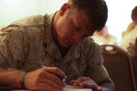Marine Corps service member works on paperwork