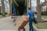 A moving contractor loads a moving truck with a service member's household goods during the permanent change of station peak-season at Scott Air Force Base, Ill. March 7, 2018. (U.S. Transportation Command/Oz Suguitan)