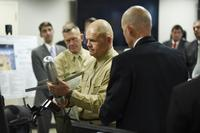 Commandant of the Marine Corps, Gen. Robert Neller, is briefed on the Advanced Capability Extended Range Mortar (ACERM) during an Office of Naval Research (ONR) awareness day. (U.S. Navy/John F. Williams)