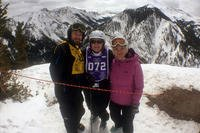 Army veteran Ted Wade, instructor Andrea Prudhomme, and Sarah Wade atop Snowmass Mountain during DAV's National Disabled Veterans Winter Sports Clinic.