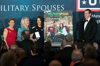 Krista Simpson Anderson, third from left, accepts the 2018 Armed Forces Insurance Military Spouse of the Year Award in Washington, D.C. May 10, 2018. With her are presenters Ellyn Dunford, Suzie Schwartz and Retired Lt. Gen. Stanley Clarke III. (Defense Department/EJ Hersom)