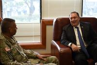 U.S. Secretary of State Mike Pompeo speaks with Gen. Vincent Brooks, United States Forces Korea commander, at Osan Air Base, Republic of Korea, June 13, 2018 (U.S. Air Force/Senior Airman Kelsey Tucker)