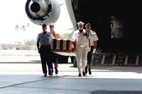 An honor guard carries a coffin with the remains of a service member killed in the Korean War. The remains were repatriated at Hickam Air Force Base, Hawaii in April 2007. (US Air Force photo/Valda Wilson)