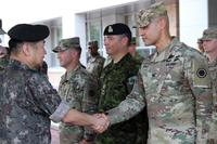Gen. Woon-Young Kim, Third Republic of Korea commanding general, greets Col. Mario Diaz, I Corps chief of staff during a cermony marking the start of their units involvement in combined, joint training exercise Ulchi Freedom Guardian, August 24, 2017. (U.S. Army/Sgt. Maj. Randy Randolph)