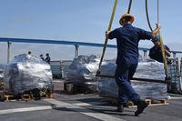 Crew members from the Coast Guard Cutter Steadfast prepare a pallet of seized cocaine to be offloaded at Tenth Avenue Marine Terminal, San Diego, July 16, 2018. Approximately 7,800 kilograms of cocaine seized in international waters in the Eastern Pacific Ocean by the crews of the cutters Steadfast and Alert were offloaded. (U.S. Coast Guard photo/Taylor Bacon)