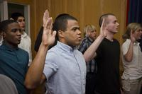 Jorge Estevez, center, recites the oath of enlistment in the Cpl. Jennifer M. Parcell Ceremony Room at the Military Entrance Processing Station aboard Fort George G. Meade, Md., Dec. 2, 2013. (U.S. Marine Corps/Cpl. Bryan Nygaard)