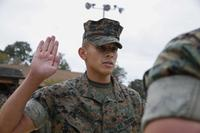 Sgt. David Hernandez, a Chemical Biological Radiological Nuclear, CBRN, Defense Specialist recites the Oath of Enlistment during his reenlistment ceremony aboard Naval Support Facility Indian Head, Oct. 13, 2017. (U.S. Marine Corps/Cpl. Maverick Mejia)