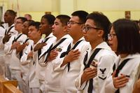 Participants in the naturalization ceremony recite the Pledge of Allegiance. (U.S. Navy/Mass Communication Specialist Seaman Timothy D. Hale)