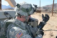 Staff Sgt. Reag Wood of 1st Combined Arms Battalion, 5th Brigade, 1st Armored Division, illustrates how he uses an iphone to obtain a visual image of a mock with insurgent activity during a field training exercise at White Sands Missile Range, N.M. (U.S. Army/Lt. Col. Deanna Bague)