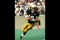 Army QB Chad Jenkins (USMA '02) in action. (Photo from Joint Base Lewis McChord Flickr page)