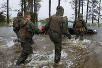 Marines with Marine Corps Base Camp Lejeune help push a car out of a flooded area during Hurricane Florence, on Marine Corps Base Camp Lejeune, Sept. 15, 2018. (U.S. Marine Corps/Lance Cpl. Isaiah Gomez)