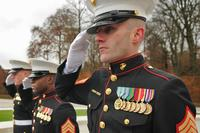 Marine Staff Sgt. Scott Pence, U.S. Embassy Marine detachment commander for marine security in Luxembourg, salutes during the Veteran's Day ceremony at the Luxembourg American Cemetery and Memoria.. (U.S. Air Force/Senior Airman Nick Wilson)