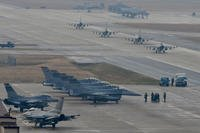 U.S. Air Force F-16 Fighting Falcon fighter aircraft, assigned to the 36th Fighter Squadron, participate in an elephant walk during Exercise VIGILANT ACE 18 at Osan Air Base, Republic of Korea. (U.S. Air Force photo/Franklin R. Ramos)