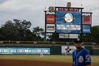 The Maxwell Air Force Base centennial logo is displayed during the warm up of a Montgomery Biscuits baseball game April 6, 2018, in Montgomery, Alabama. (Charles Welty/Air Force)