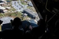 John W. Henderson, left, the Assistant Secretary of the Air Force for Installations, Environment and Energy, and Secretary of the Air Force Heather Wilson, right, look at the aftermath left from Hurricane Michael from a CV-22 Osprey tiltrotor aircraft assigned to the 8th Special Operations Squadron above northwest Florida, Oct. 14, 2018.  (Joseph Pick/U.S. Air Force)