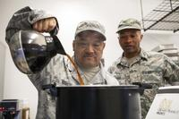 Tech. Sgt. Carlos Ramon, of the 163d Force Support Squadron, pours a small pot of coffee into a larger container that serves 101 cups, April 2, 2017, at March Air Reserve Base, California. (Air National Guard/Airman 1st Class Crystal Housman)