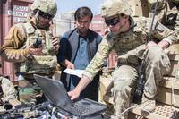 Spc. Stephen Powers, right, a communications adviser with Combat Adviser Team 1131, uses the Afghan National Tracking System to show his counterparts where Afghan soldiers are located during a clearing operation near Kabul, Afghanistan, on Sept. 16, 2018. (U.S. Army photo by Sean Kimmons)