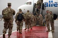 FILE -- Soldiers from 151st Regional Support Group, Massachusetts National Guard board an aircraft destined for Fort Hood, Texas here Jan. 23, 2018. The citizen-soldiers are scheduled to deploy to Kuwait in support of Operation Spartan Shield. (US Army photo by Spc. Samuel D. Keenan)