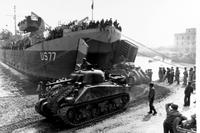 M-4 Sherman tanks attached to the Fifth Army land on the beach during the 1944 invasion of Anzio, Italy, where an Army private witnessed an act of cowardice by his platoon leader. (Photo courtesy of Naval History and Heritage Command)