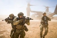 A joint special forces team move together out of a U.S. Air Force CV-22 Osprey Feb. 26, 2018, at Melrose Training Range, New Mexico. (U.S. Air Force photo/Clayton Cupit)