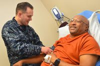 Hospitalman Payton Dupuis checks veteran Joseph Levette's blood pressure at Naval Hospital Jacksonville's internal medicine clinic, May 10, 2018. (U.S. Navy photo/Jacob Sippel)