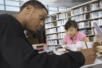 Two College Students Study In Library