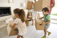 Kids help with the boxes on moving day.