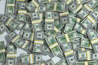 Packs of hundred dollar bills. Photo courtesy of Pixabay.