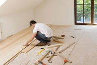 contractor laying flooring