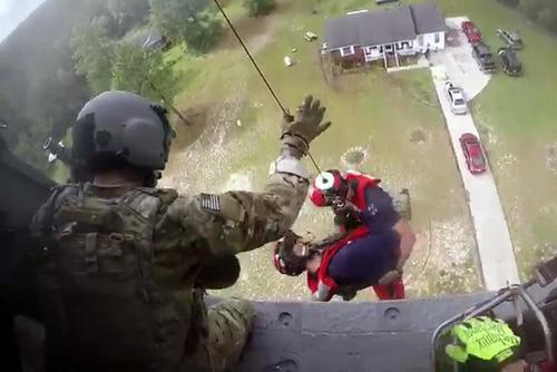 Members of the 106th Rescue Squadron, 106th Rescue Wing, New York Air National Guard, drop from an HH-60 Pavehawk during a rescue mission during Hurricane Florence, Sept. 17, 2018.(U.S. Air Force/Senior Airman Kyle Hagan)