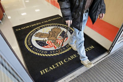 In this April 2, 2015, file photo, a visitor leaves the Sacramento Veterans Affairs Medical Center in Rancho Cordova, Calif. (AP Photo/Rich Pedroncelli, File)